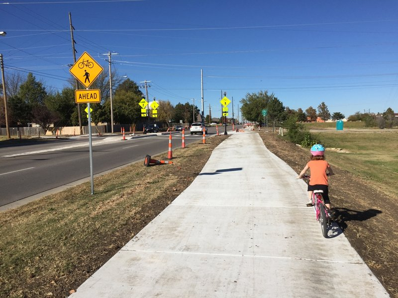 Connection to the Red Bud trail!  The lights for crossing Woodlawn are NOT stoplights, only warning lights. Use caution.