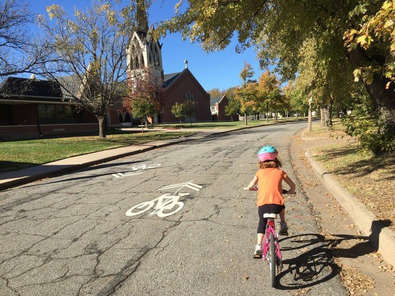 Riding past St. Thomas Aquinas School