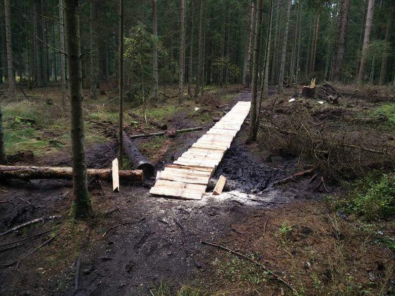 New 12m long bridge built in October 2015, using hand chopped larch.