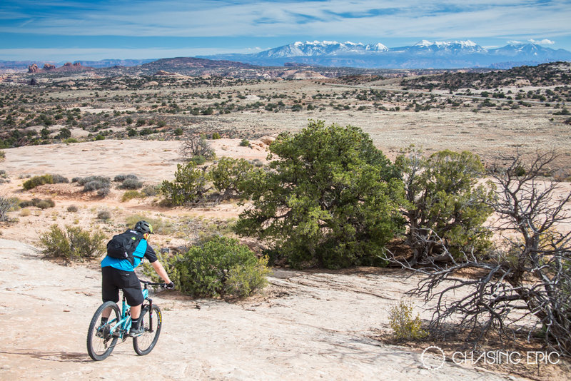 Finishing up the ride on Navajo Rocks with the snow-covered La Sals in the distance.