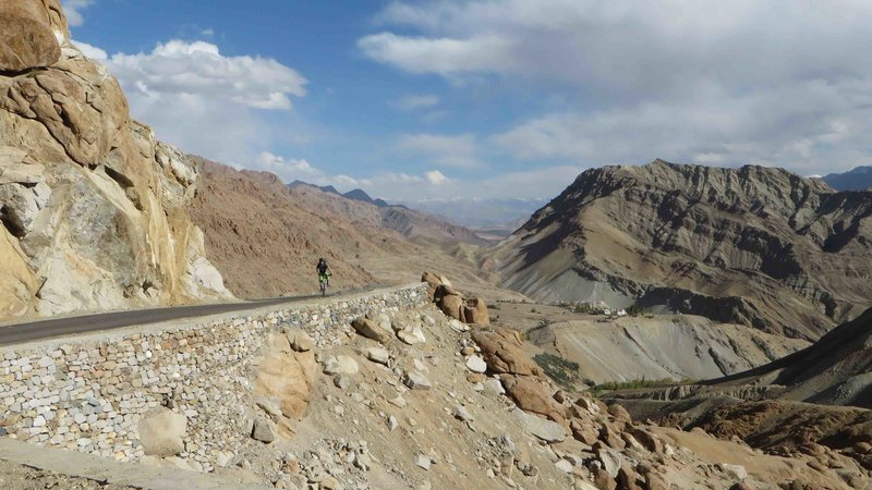 The road up to Tsarmangchan La. In the background the village of Yangthang and Charatse pass as seen from the Likir- Hemis tour.