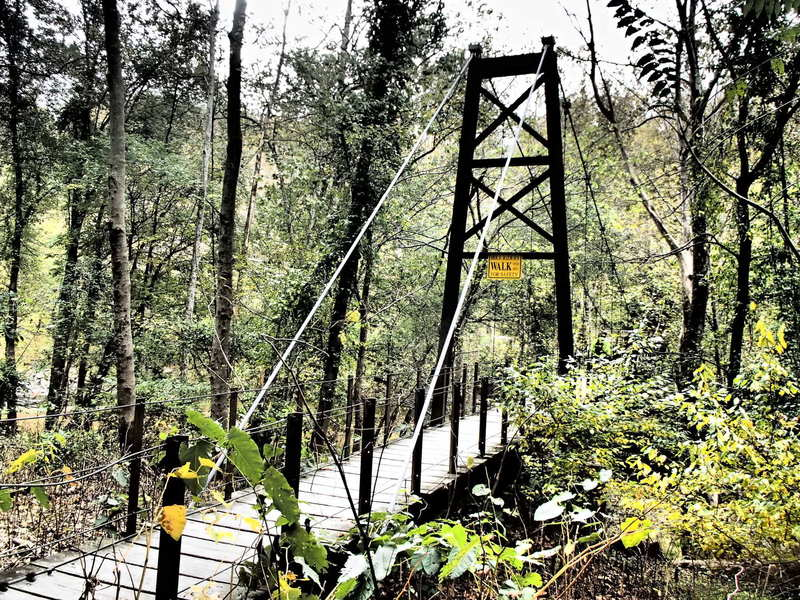 The Swinging Bridge greets riders as they pass over the Patapsco River