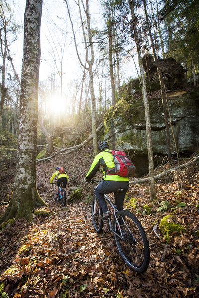 Pedaling under big cliffs on the traverse between Difficulty Creek and Troublesome Creek.