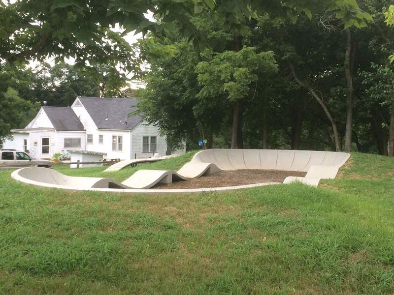 """A concrete pump track inside the """"skills area"""" at the Two Rivers Mountain Bike Park."""
