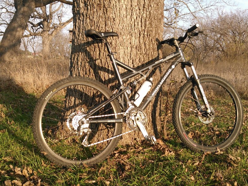 The 07 Iron Horse Azure against one of the many pecan trees.