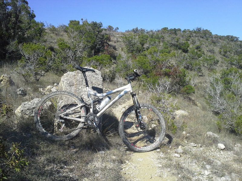 The 2006 SWorks Stumpjumper along a flowing and hill hugging section of the Lakeway AKA LAME Trails.