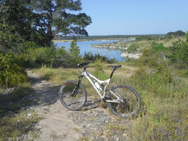 The 2006 SWorks along the Goodwater Loop with Lake Georgetown and the prehistoric<br> Native American shelter and burned midden in the background.