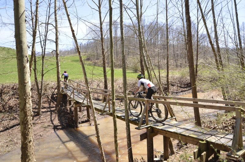 Racers on Walker Creek bridge on Tomahawk Trail.