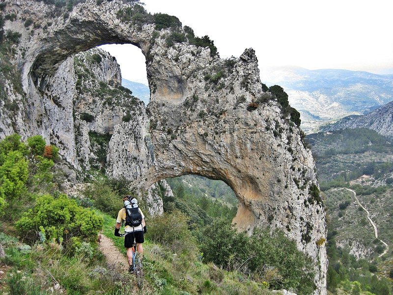 "Take a moment to appreciate the Rock Arch of ""Atanços"" on your way up the Xorta."
