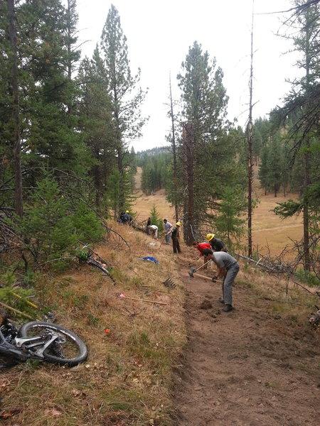 Volunteers rerouting the Fenceline Trail.