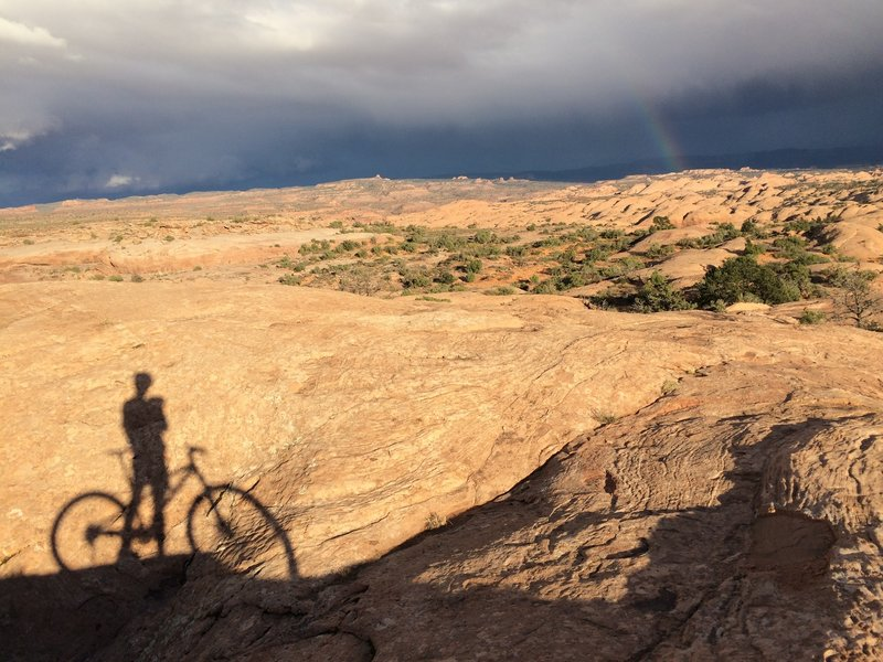 Evening rain showers and the setting sun bring the sandstone contours to life.