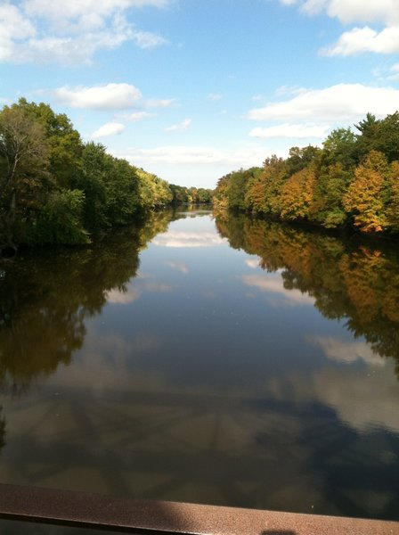 At mile 10.5 is the trail bridge at Springtown Road. It offers peaceful views of the often swiftly-moving Wallkill River as it flows north. You can see the shadow of the bridge on the water below in this photo.