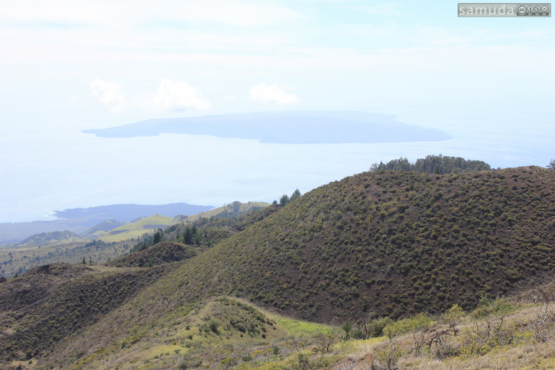Ridge line view with Kahoʻolawe in the distance.