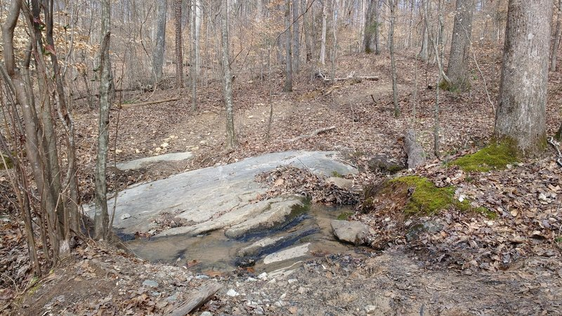 Natural rock surface, creek crossing.