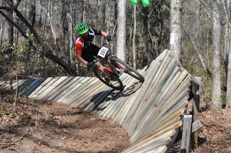 """CCORS Race 2014 riding The Wall at Hendo. (Pay no attention to the """"little green man"""" floating above the feature.)"""