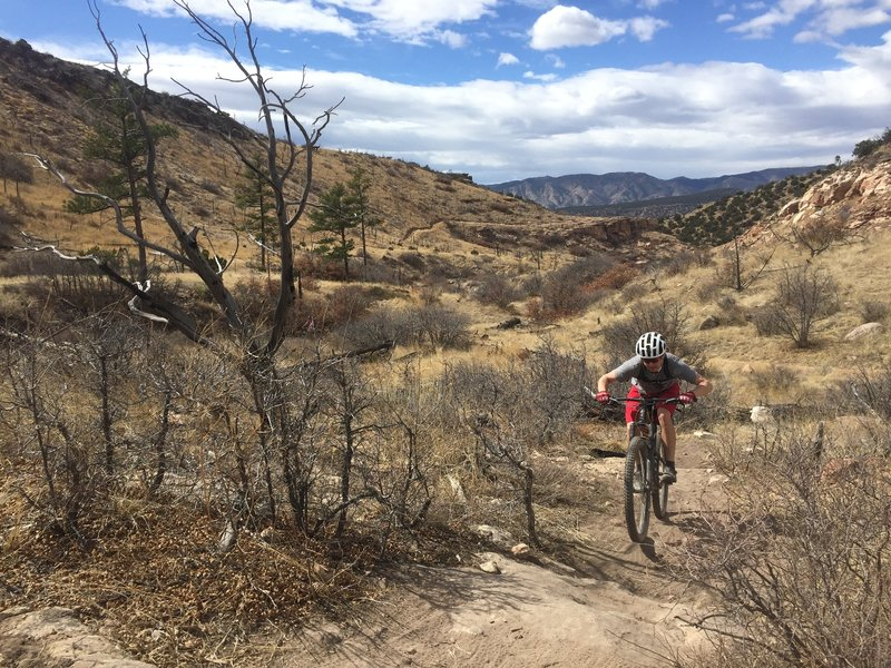 Riding up some tech on Fire Canyon.