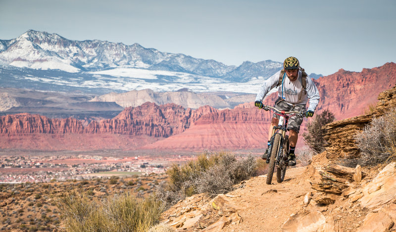Rounding the corner on Sidewinder with the beautiful Snow Canyon and Pine Mountains in the background.