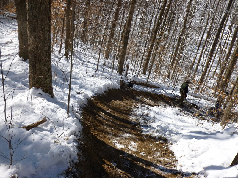Trail maintenance never stops at Mountwood - RVMBA laying down some sweet bermage on The Dark Side of the Moon trail on a bone-cold January day.