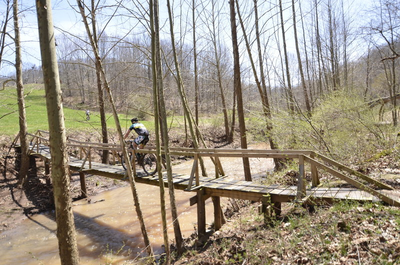 Racers cross the Walker Creek bridge during the Challenge At Mountwood WVMBA points series race.