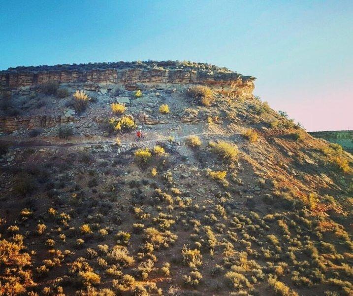 Ledge riding at Deadringer Trail at sunset.