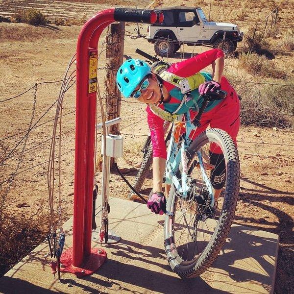 Very bike friendly bike repair stand in the parking lot.