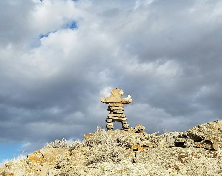 """The """"Rock Man"""" goes through many iterations as the winds he is exposed to take their toll. The trail wraps around the knob he stands guard over."""