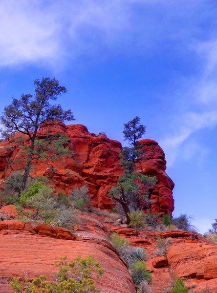 Red rock looms over the Broken Arrow Trail.