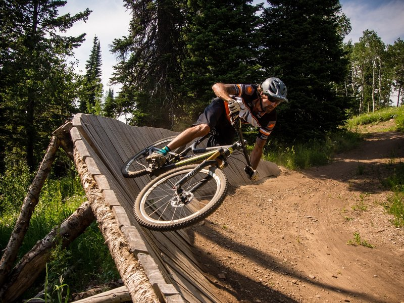 Habitat rider Bryon Vordermann rails the first wall ride on the Chutes & Ladders trail at Grand Targhee Bike Park. Photo: Dana Ramos - Instagram: @dnasince1979