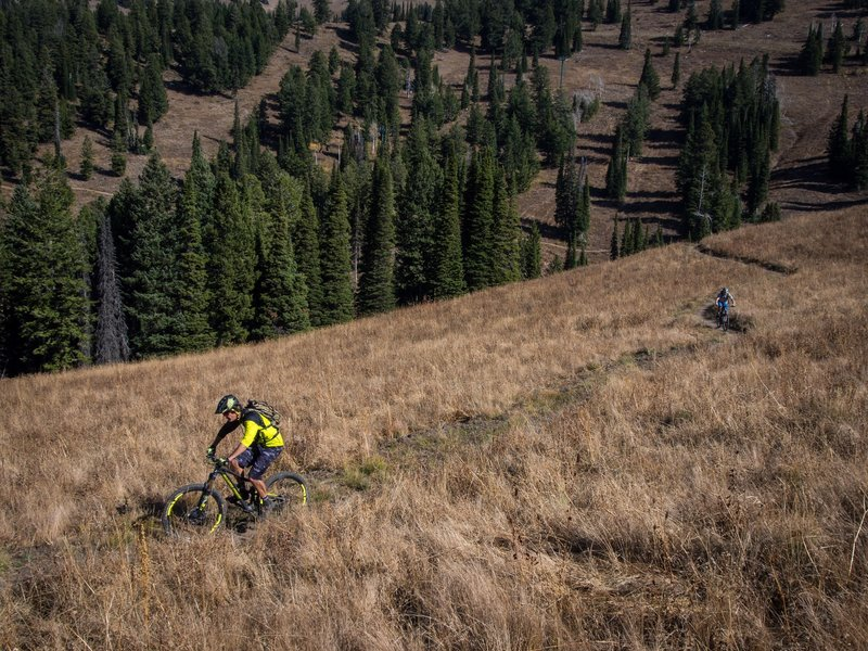 Mitch, manager of Habitat Bike Shop in Driggs, ID and Geordi, owner of Grand Targhee Resort in Alta, WY traverse Action Jackson on their way out to Colter's Escape and Mill Creek.