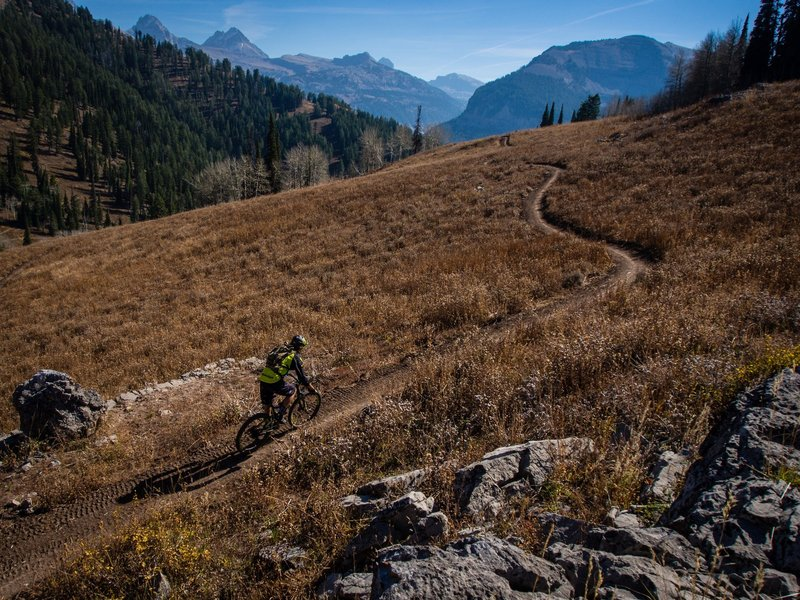 Into the Tetons. Rider Mitch Prissel ventures out on the brand new Rocky Mountain Way trail at Grand Targhee Resort towards Mill Creek and Teton Canyon. Photo: Dana Ramos - Instagram: @dnasince1979