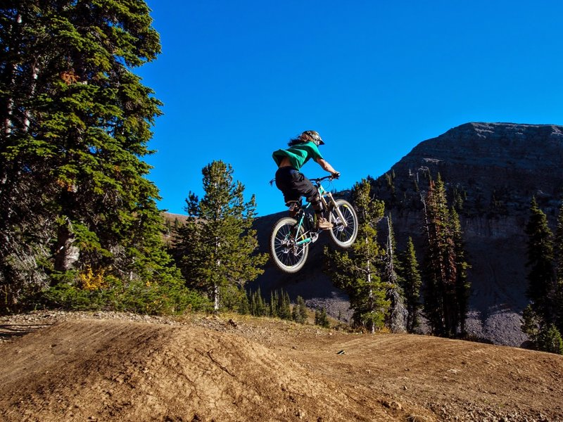 Rider Tait Trautman gets a boost on the Buffalo Drop trail at Grand Targhee Bike Park in Alta, WY. 