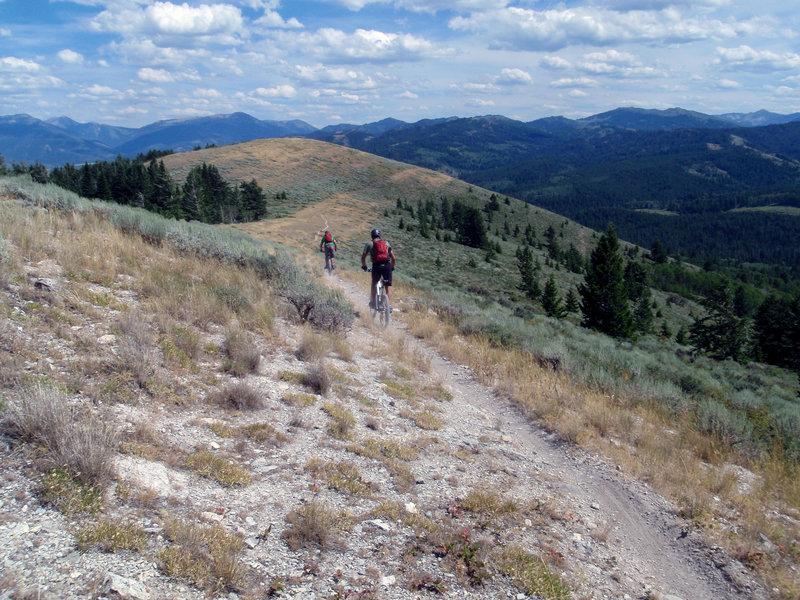 Riders Alex Larsen and Chris Lander coasting down the ridge on the Rocky Peak trail. <br> Photo: Dana Ramos - Instagram: @dnasince1979