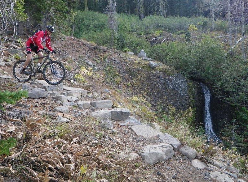 Did I mention the steps? Kevin Joell (TAMBA president emeritus) rides the waterfall steps on a hardtail.