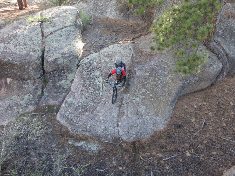 Dropping down a steep rock face... so many lines to try out!