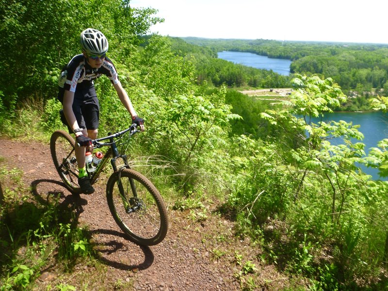 Cresting the climb on Miners Mountain, enjoying the view, ready for a fun descent.