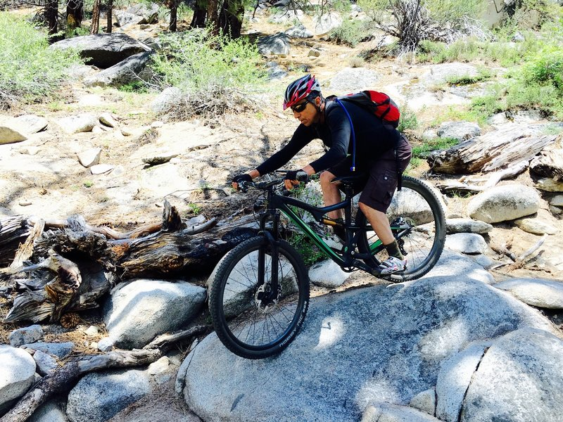"""Amazing rock section on the Cold Creek Trail. There are two class V lines """"expert"""" and """"big air"""". Here is Jim """"cleaning it""""."""