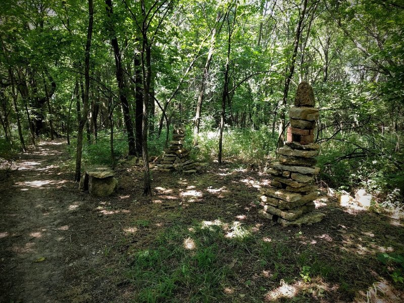 The rock cairn, a small arch, and a rustic bench on the Mt. Lehigh Trail at Lehigh Portland Trails.