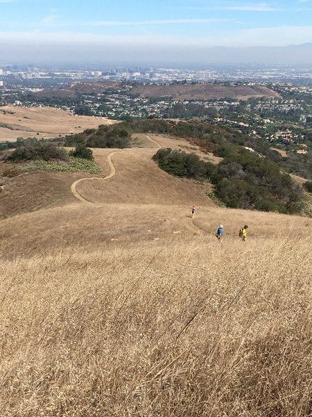 Looking down Ridge Route with sweeping views of Irvine, Saddleback Mountain and beyond.