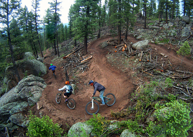 Cool people riding their own creation - the crew of Tony Boone Trails LLC.