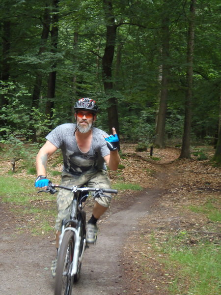 Coming out of a piece of fast forest singletrack, into a clearing.