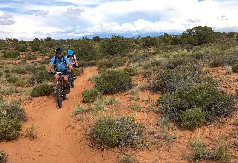 The bottom couple miles of this trail are an easy roll through the hard-pack sand a sagebrush.