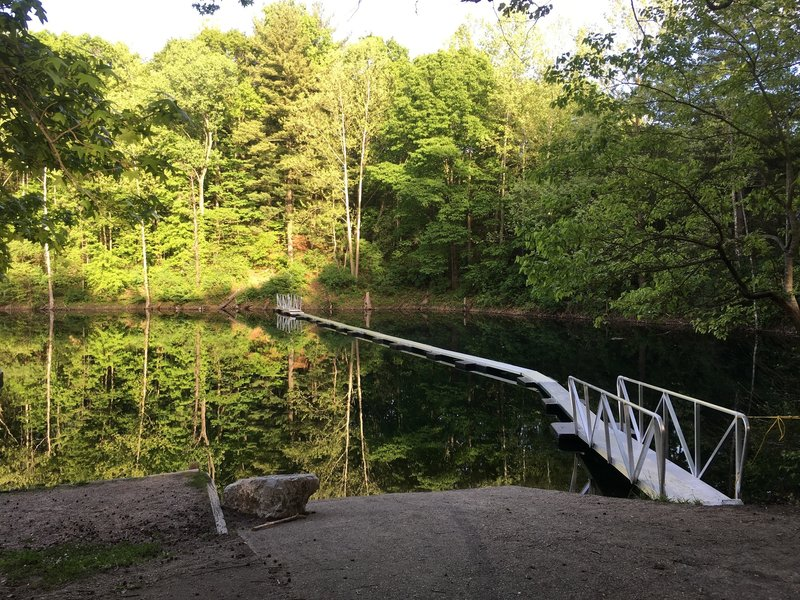 Floating pontoon bridge on Stryker Lake.