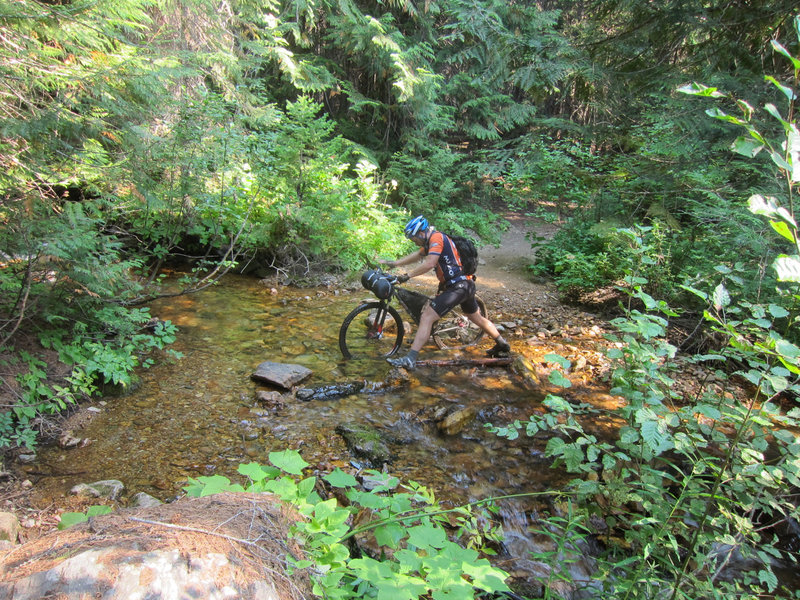 Crossing a creek on the North Fork Fish Creek Trail.