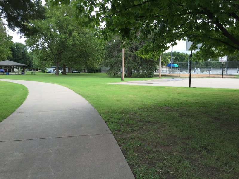 The path takes you to the local swimming pool and city park