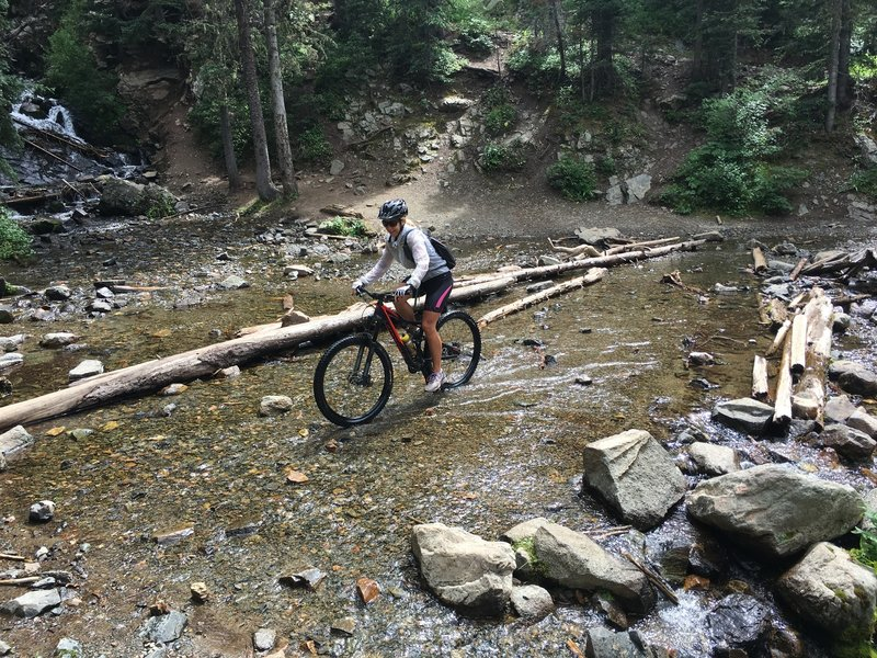 Rebecca riding middle fork trail/forest road #487 to lost lake. Red River, New Mexico 8/10/16