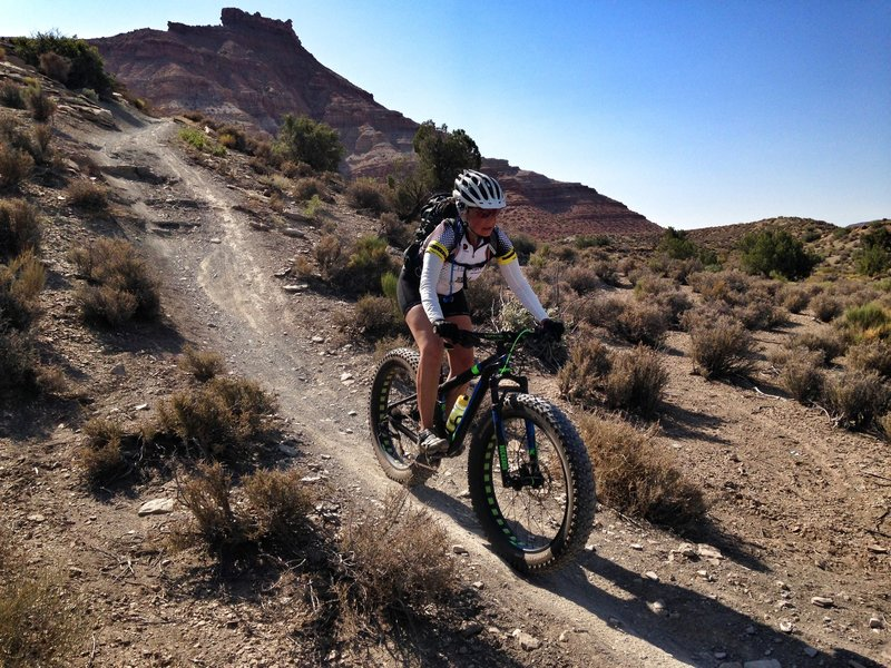 Susan Bryan dropping in with the 4.6 fatty tires at the JEM trail Utah.