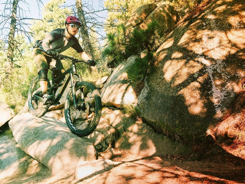 Fun features and tight switchbacks on the east side of Sisters Trail.