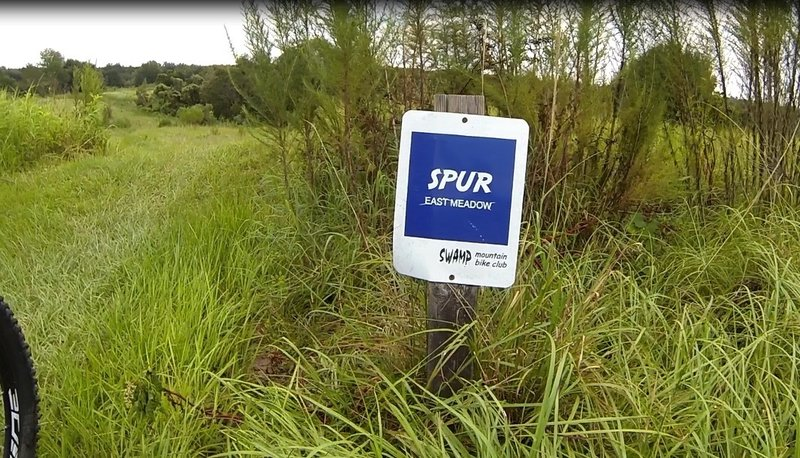 Spur Trail Sign at top of the run... Small Jump just moments away!