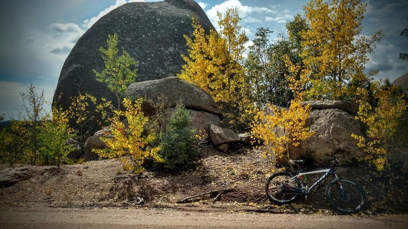 Large boulders and aspen groves line Mount Herman Road.