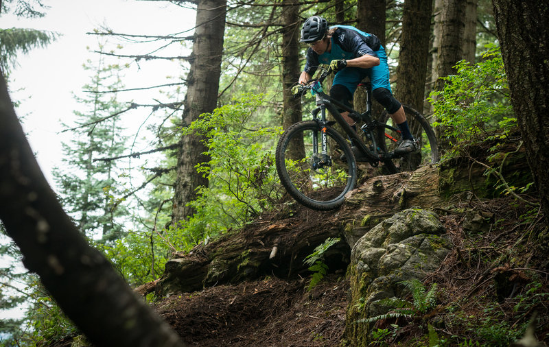 Nick Hardin navigates an optional log drop on the Cold Creek Trail during the Cascadia Dirt Cup.